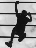 Boy Climbing on Jungle Gym