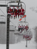 Skiers and Snowboarders Dressed as Santa Claus Ride up the Ski Lift
