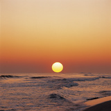 Yellow Sun in Sunset Over Ocean Waves