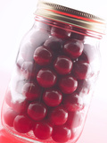 Red Gumballs in Glass Jar