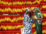 Villagers Walk Past Freshly Dyed Kalawa  a Sacred Orange-Yellow Thread Used in Hindu Rituals