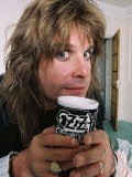Black Sabbath Singer Ozzy Osbourne Enjoying a Drink Form His Personalised Mug at His Home in 1988