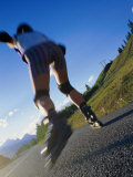 Woman Roller-Blading Along Mountain Road  Canada