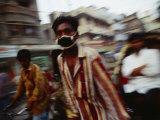 A Rickshaw Driver Wears a Mask to Keep Pollution Out of His Lungs in Dhaka