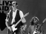 Francis Rossi Lead Singer with Pop Group Status Quo Singing on Stage at Live Aid Contest