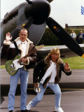 Status Quo Members Francis Rossi and Rick Parfitt Posing by a Spitfire Aircraft in Northolt