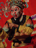 A Chinese Opera Performer in Monkey Makeup and Costume