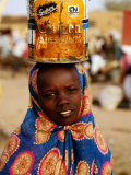Girl in Colourful Wrap Balancing Paint Tin on Head  Agadez  Niger