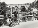 Two Cyclists Take a Break on a Bridge Over the River Nidd at Knaresborough