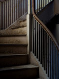 Winding Staircase with Banister in an Old Mansion