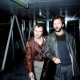 Phil Collins with Eric Clapton Leaving London Airport for Barbados  March 1984