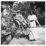 European Gentleman in a Solar Topee is About to be Taken in a Rickshaw in Ceylon