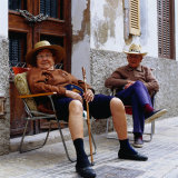 Elderly Couple Relaxing Outside Their House  Palma De Mallorca  Spain