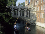 Tourists Pole Boats Called Punts Under the Bridge of Sighs on the Cam  Cambridge  England