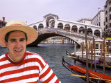 Gondolier by the Rialto Bridge  Venice  Italy