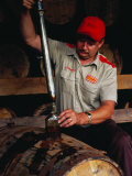Taking Sample from Whisky Barrel at Makers Mark Distillery  Bardstown  United States of America