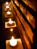Lighted Candles and Brick Wall