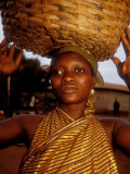 Woman Wearing Gold Fabric Dress and Carrying Basket  Kabile  Brong-Ahafo Region  Ghana