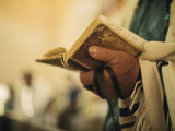 Man Holding a Prayer Book and Tefillin During a Synagogue Service  Israel