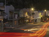 Car Lights at Night in the Gold Rush Town of Angels Camp  California