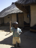 Child by Straw Hut  South Africa