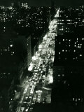 View of New York Illuminated at Night  Traffic Stretches for Miles as Cars Pour into the City