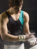 Male Gymnast Putting Chalk on his Hands  Bainbridge Island  Washington State  USA