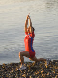Woman Practicing Yoga on the Riverside  Bainbridge Island  Washington State  USA