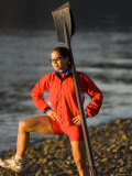 Woman Standing with Oars Leaning Against Her Shoulder  Bainbridge Island  Washington State  USA