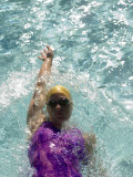 Young Woman Swimming the Backstroke in a Swimming Pool  Bainbridge Island  Washington  USA