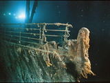"Bow Railing of RMS ""Titanic"" Illuminated by Mir 1 Submersible Behind the for Ward Anchor Crane"