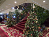 Christmas Trees at the Bottom of an Elegant Stairway on a Cruise Ship
