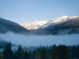 Sunrise Over the Mountains on a Fall Day Shows Snow