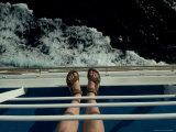 Man's Feet in Sandals Standing on the Railing of a Cruise Ship