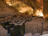 Barrels of Water and Crates of Food are Stored for Emergency in a Cave
