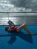 Woman Reading a Book on the Deck of a Cruise Ship