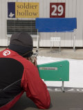 A Man Shoots at a Target in the Distance During a Biathalon