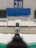 A Rifle Points at a Target on a Range at a Biathalete Center
