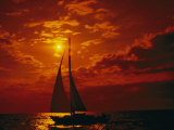 A Silhouette of a Sailboat on Lake Michigan