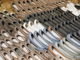 Pairs of Shoes at a Korean Market Resemble Dug-Out Canoes