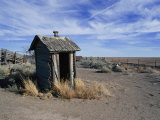 An Old Outhouse Leans with Age and Decay