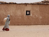 A Refugee from Western Sahara Leaves a Red Cross Food Distribution Center