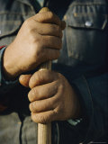 View of the Hands Holding the Handle of a Shovel