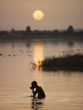 Person Bathing in the Niger River