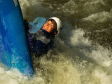 A Kayaker Flips in the Rapids