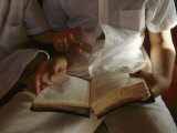 Reading an Old Bible During a Service