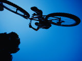A Mountain Biker Careens in the Air and the Photographer Captures This Dynamic Image from Beneath