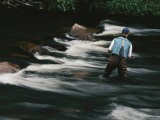 Water Flows Past a Fisherman Casting His Line