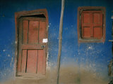Faded Blue and Red Paint Cover the Entrance to a Dwelling in Addis Ababa