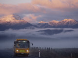 Bus at Sunrise with the Mountains Covered in a Blanket of Fog